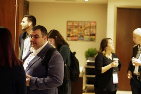 Edge by Ascential employees networking at an event