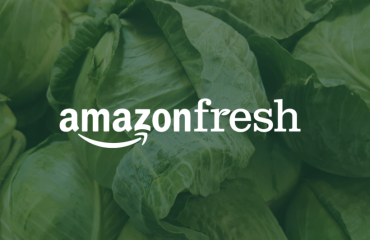 Amazonfresh logo in front of a batch of lettuce heads