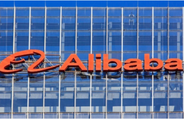 Large orange Alibaba logo on a building