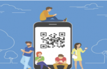 People in a park surrounding a mobile device with QR code in the middle